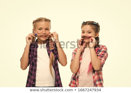 girl playing plaiting friends hair stock photo © is2