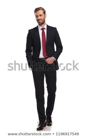 businessman in navy suit and red tie stepping to side Stock photo © feedough