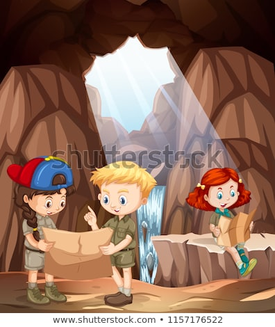 Boy and girl scout exploring the cave Stock photo © bluering