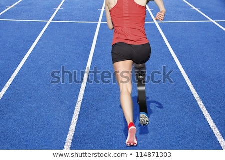 Image of athletic handicapped woman with prosthesis in tracksuit Stock photo © deandrobot