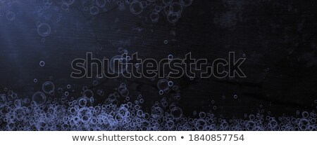 glassy spheres floating on the water Stock photo © Artida
