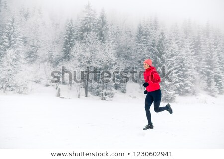 woman running on winter trail in forest fitness inspiration stock photo © blasbike
