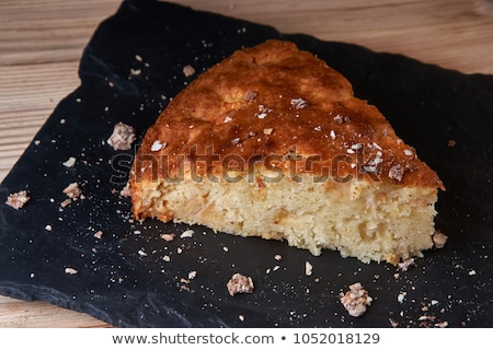 Fresh baked apple pie with cutted slice on small plate stock photo © dash