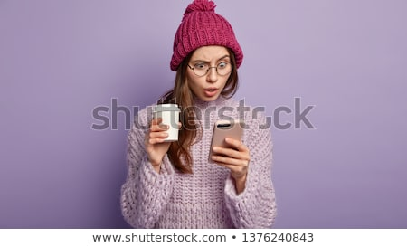 Portrait of a shocked young woman dressed in sweater Stock photo © deandrobot