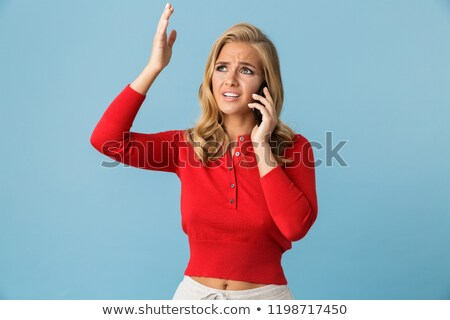 portrait of angry blond woman 20s wearing red shirt screaming an stock photo © deandrobot