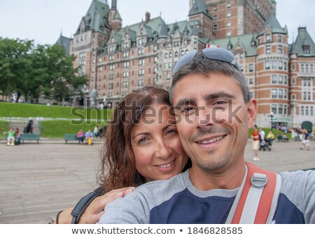 men in front of Chateau Frontenac in Quebec city Stock photo © Lopolo