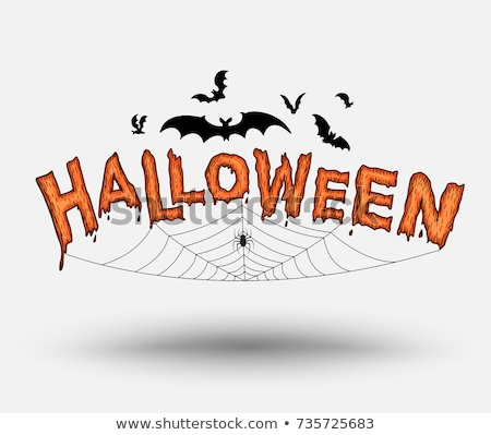 halloween pumpkins with bats and spider web stock photo © dolgachov