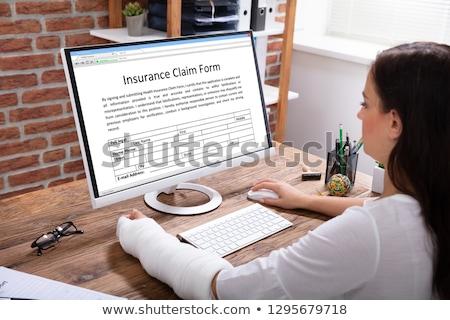 injured woman filling work injury claim form stock photo © andreypopov