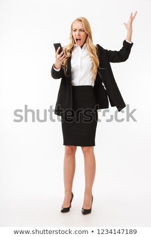 full length photo of displeased businesswoman wearing office sui stock photo © deandrobot