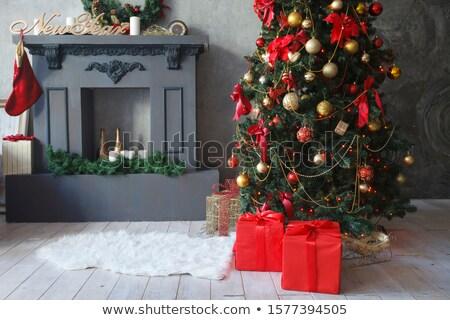 Foto stock: Gift Boxes On Sheepskin At Christmas Tree