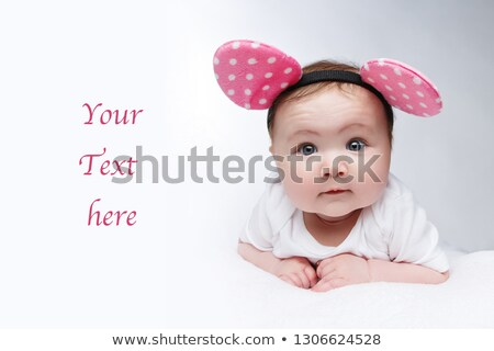 funny little baby girl in mouse ears headband Stock photo © svetography