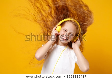 幸せ 赤 十代の少女 イヤホン ラップトップを使用して コンピュータ ストックフォト © deandrobot