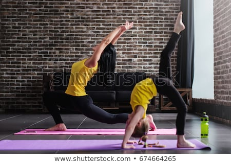 Adult Woman Training Legs Doing Inverted Lunges Exercise Stock photo © diego_cervo