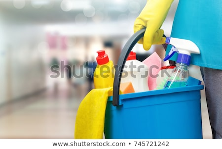 Hands with bucket of cleaning products. Stock photo © Kurhan