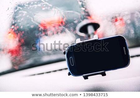 Smart phone on holder, rainy weather seen through wind shield, c Stock photo © amok