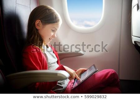 Dziewczynka cyfrowe tabletka lotu godny podziwu słuchawek Zdjęcia stock © AndreyPopov