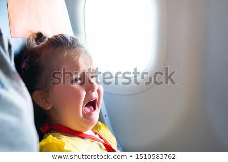 Girl Screaming On Airplane Stock photo © AndreyPopov