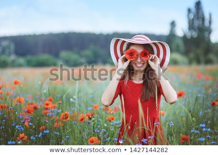 женщину красные цветы области улыбающаяся женщина белое платье Сток-фото © lichtmeister