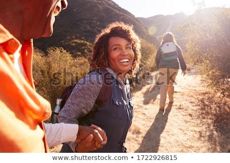Mulher caminhadas caminho caminhada paisagem verde Foto stock © lichtmeister