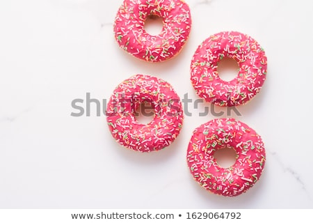 Frosted sprinkled donuts, sweet pastry dessert on marble table b Stock photo © Anneleven