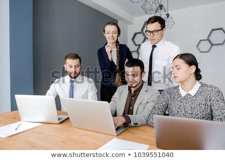 üzlet vállalkozó kollégák megbeszél projekt ötletelés Stock fotó © snowing
