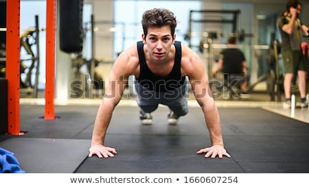 Young Men Doing Exercise For Biceps Stock photo © Jasminko