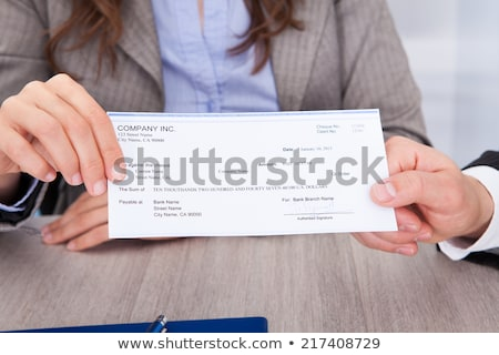 Human Hand Giving Cheque Stock photo © AndreyPopov