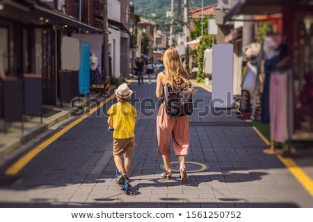 Mom and son tourists in Bukchon Hanok Village is one of the famous place for Korean traditional hous Stock photo © galitskaya