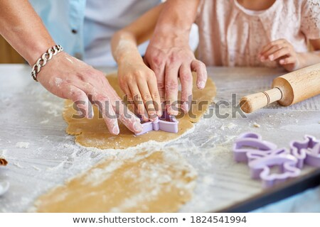 Father and daughter make cookies by mold Stock photo © Illia