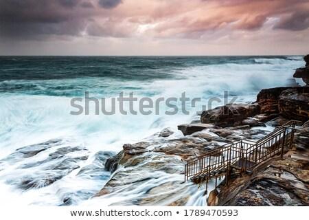 Grande rocha prateleira pôr do sol direito para cima Foto stock © lovleah