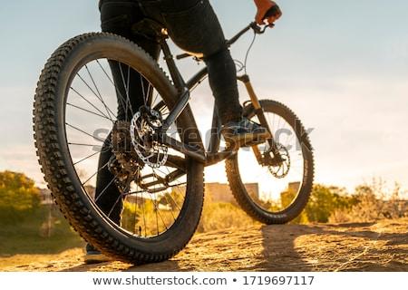 Bicicleta roda movimento blue sky esportes bicicleta Foto stock © MichaelVorobiev