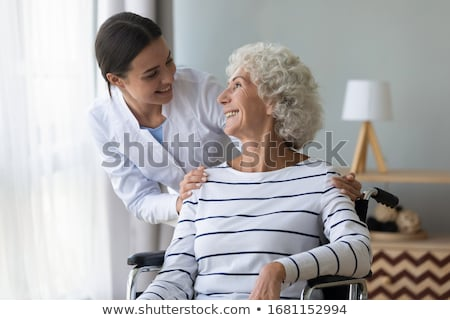 Elderly woman and young female caregiver at home Stock photo © photography33