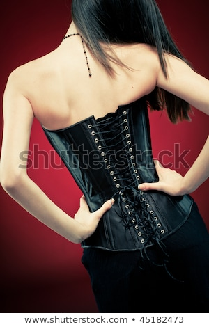 close up shot of woman in black corset stock photo © elisanth