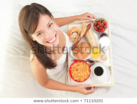 woman having breakfast in bed healthy continental breakfast ca stock photo © hasloo