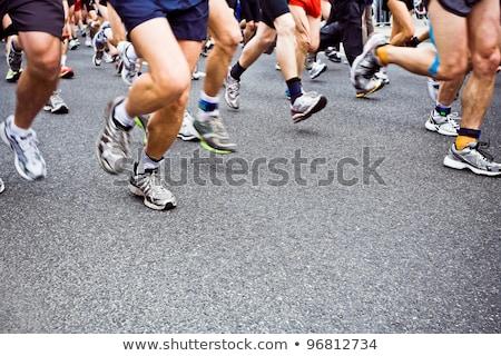 man running in city marathon blurred motion stock photo © blasbike