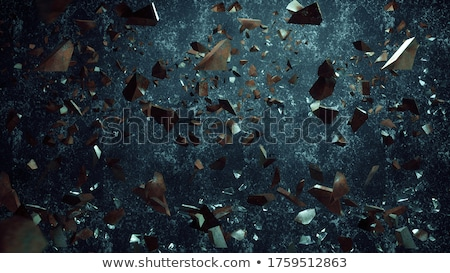 Falling pieces of broken glass on blue background Stock photo © antkevyv