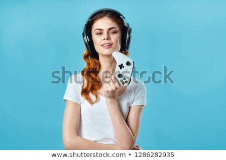 Emotional female gamer with a game controller Stock photo © Nobilior