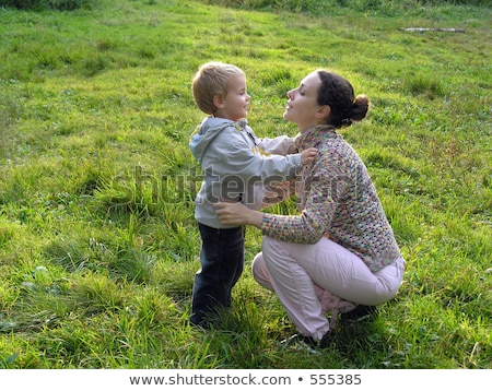 ma with son in opposite light on sundown Stock photo © Paha_L
