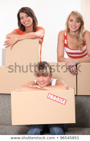 three young women posing in a room full of unpacked packages Stock photo © photography33