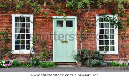 old door and window of brick building stock photo © frank11