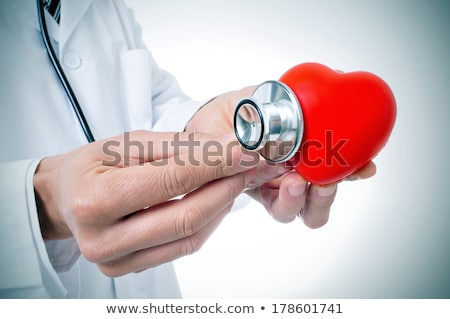 a surgeon auscultating a heart Stock photo © photography33