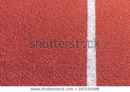 Curve on a red running track in arena  Stock photo © inxti