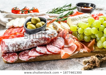 Stock photo: deliscious antipasti plate with parma parmesan olives