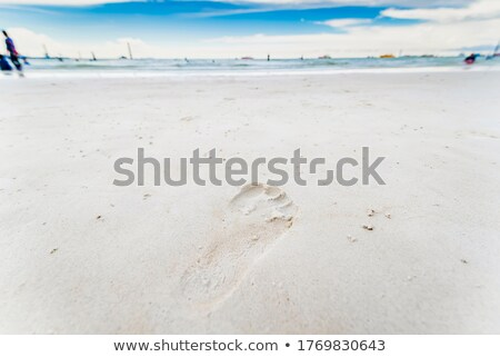 footprints in sand on empty beach on a beautiful winters day stock photo © morrbyte