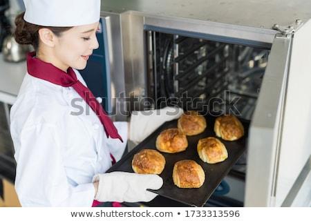 Bright female chef baking bread Stock photo © wavebreak_media