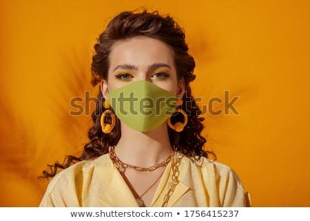 yellow necklace mask stock photo © carlodapino