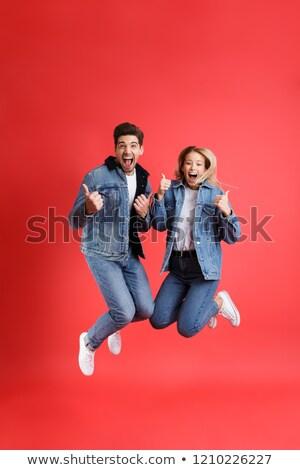 Femme sautant pouce up s'adapter heureux Photo stock © godfer