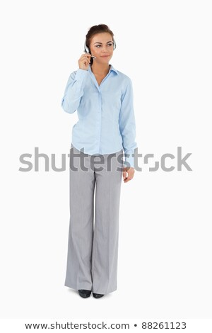 Businesswoman listening to caller with headset on against a white background Stock photo © wavebreak_media