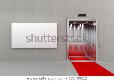 elevator with red carpet and billboard stock photo © creisinger