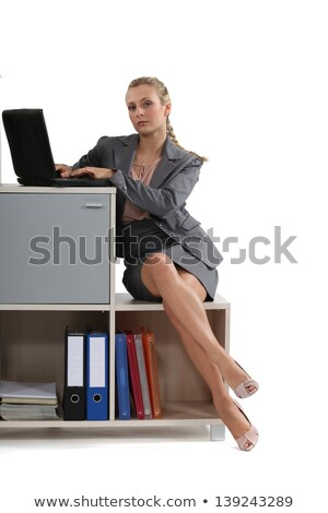 Woman perched on office storage furniture Stock photo © photography33